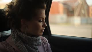 girl riding in a taxi and looking out the window