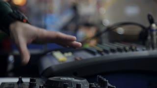 Hands DJ behind the decks