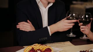 happy couple have a romantic date in a fine dining restaurant they drink wine