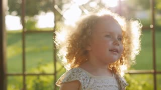 happy curly girl laughing in the sunset light