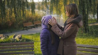 happy mother with her daughter in the autumn park. slow-motion