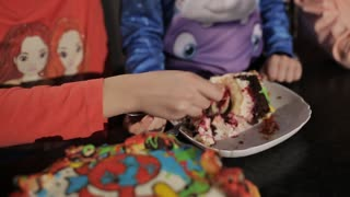 Little child girl eating with fork a sweet tasty cake with jam in restaurant
