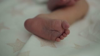 little feet a newborn baby