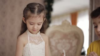 little girl with long hair in a beautiful dress