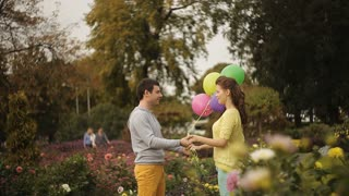 loving couple in the park releases balloons in the sky