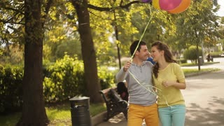 man and woman in love. lovers fly holding on balloons