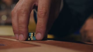 Man checks out his card in poker