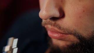 Man Exhaling smoke from a vaporizer
