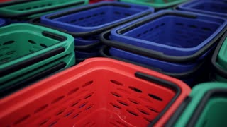 Multicolored shopping basket in the supermarket lobby