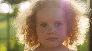 Portrait of beautiful curly girl in sunset light