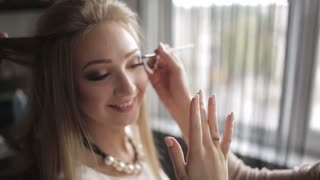 Ring girl shows that she has made an offer sweetheart until her do her hair and makeup