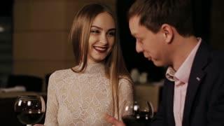 Romantic couple at a restaurant looking at the menu