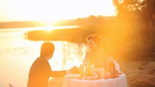 Romantic Couple Enjoying Glass of Champagne at Sunset
