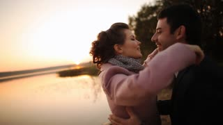 romantic lovers with sunset
