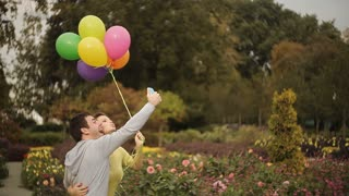 selfie lovers in the park with balloons