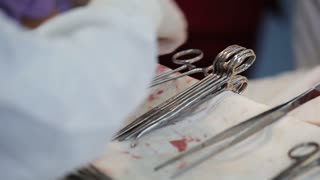 surgical instruments contaminated with blood on the table in the operating room. close-up