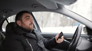taxi driver carries the passenger. Due to the negligence of the driver almost gets into an accident. The driver looks at the phone and creates an emergency situation on the road