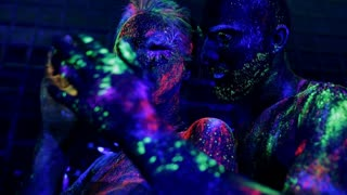 Tender touch of loving couple in ultraviolet light.