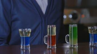 The bartender puts on the bar set of cocktails.