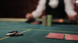 The dealer moves the winning player