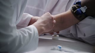 the doctor treats patient's arm for injection