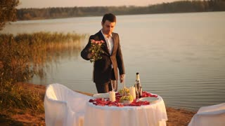the guy puts a rose in a vase ready for a date