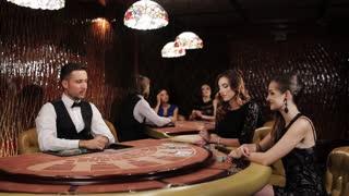 Two Beautiful Women Playing in a Casino