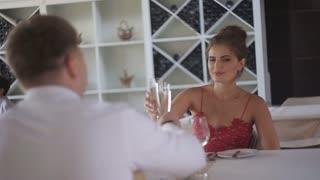 beautiful couple toasting at cafe