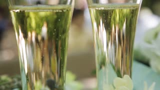 Bubbles of champagne in wedding glasses