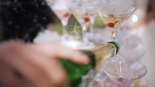 champagne slide for parties. Glasses with champagne and dry ice in the form of a slide at the wedding