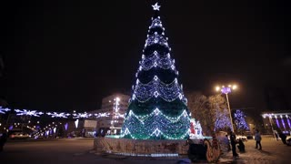 Christmass tree with garland at evening city