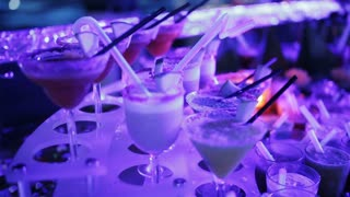 Close-up of a large number of cocktails on the table at the party
