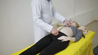 Doctor measuring pregnant woman's belly