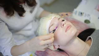 Eyelash Extension Procedure. Woman Eye with Long Eyelashes. Lashes, close up