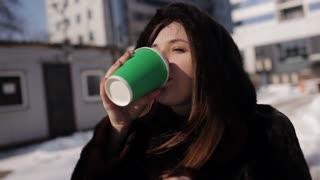 Girl in a fur coat winter warm aromatic coffee
