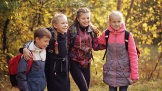 Happy children laugh in the park