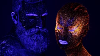 Man and woman face in ultraviolet light