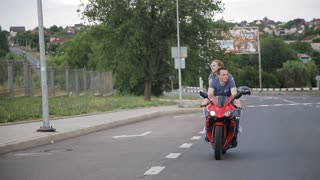 Man and woman on a motorcycle outdoors. young beautiful couple on a motorcycle in the city.
