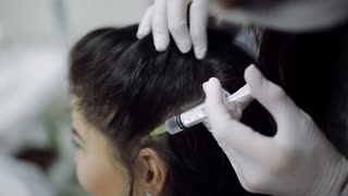 Mesotherapy of the scalp. treatment of alopecia. close-up