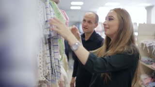 purchase of children's clothes in the store during pregnancy