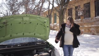 The car broke down a pregnant woman in the winter.