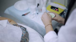 the doctor-cosmetologist prepares a medical mask for problem and acne skin