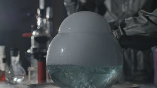 The scientist and his assistant conduct chemical experiments in an underground laboratory in Slow motion