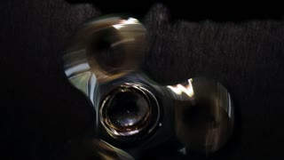 Wedding rings of the bride and groom rotate on the spinner. close-up