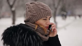woman talking on the phone winter park