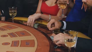 young and beautiful people, girls and a guy playing in a casino