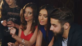 young and beautiful people play casino