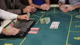 young attractive guy won playing poker in casino
