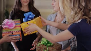 young beautiful girls give gifts to the birthday girl