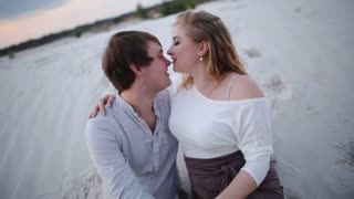 young couple kissing background career